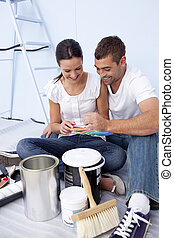 Couple with colour samples to paint new house