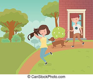 couple with cute little cat and dog in the house garden