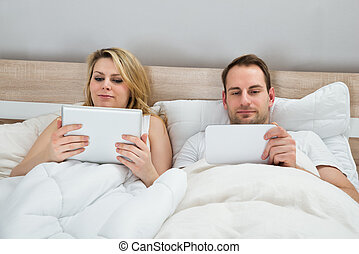 Couple With Digital Tablets