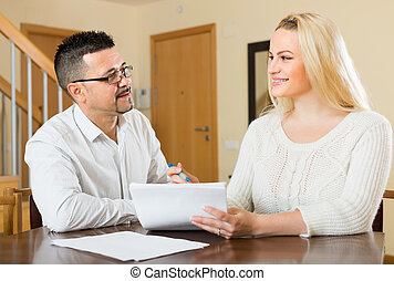 Couple with documents at home