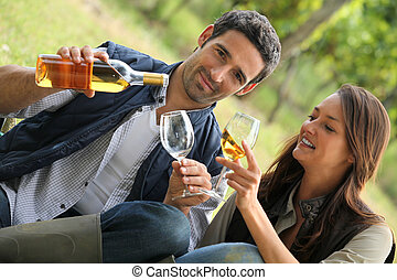 couple with drinks in the countryside