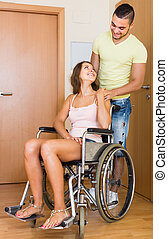 couple with female in wheelchair near doors