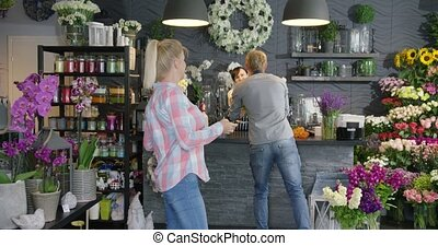 Couple with flowers in shop