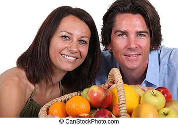 Couple with fruit basket