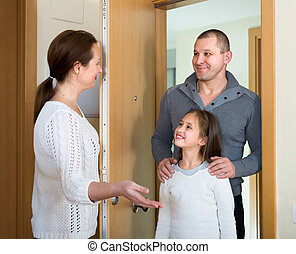 Couple with girl at doorway