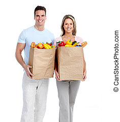 Couple with grocery bag.