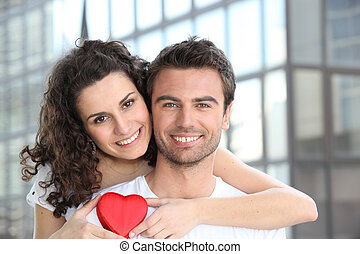 Couple with heart shaped gift
