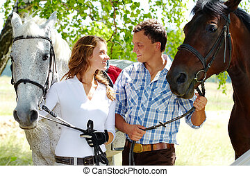 Couple with horses - Image of happy couple with purebred ...