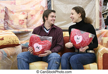 couple with love hearts in furniture shop