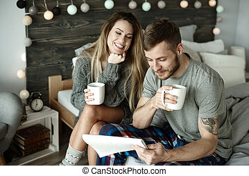 Couple with morning coffee and newspaper