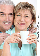 Couple with mug of coffee