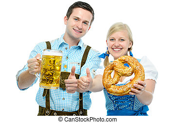 Couple with Oktoberfest beer steins and pretzel