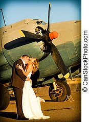 couple with old war Albatross plane