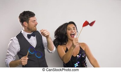 couple with party props having fun and dancing -...