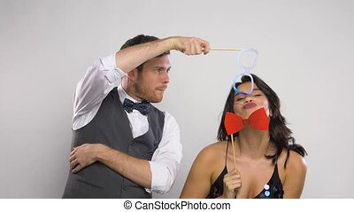 couple with party props having fun and posing - celebration,...