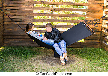 Couple With Pregnant Woman Relaxing Together