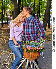 Couple with retro bike in the park