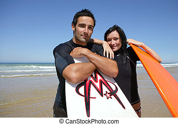 Couple with surf boards
