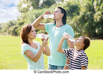 couple with teenager drinking water
