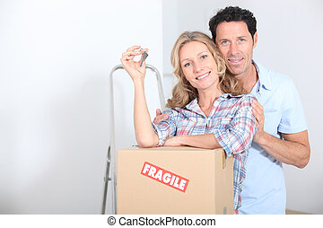 Couple with the keys of new flat