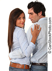 Couple with their arms around each other