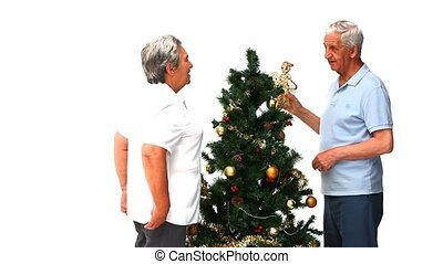 Couple with their Cristmas tree