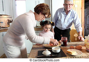 Couple with their grandchild at breakfast