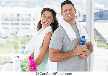 Couple with towels and water bottle