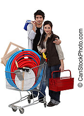 Couple with trolley full of DIY equipment