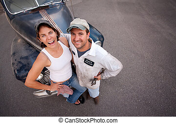 Couple with Vintage Car - Couple posing with vintage sedan...