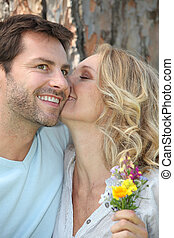 Couple with wild flowers