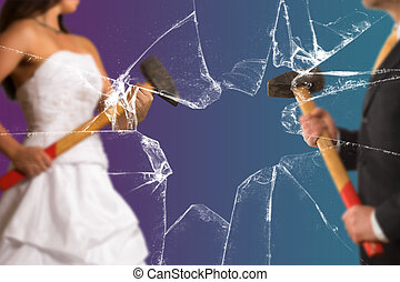 Couple with with Sledgehammer behind a broken Window