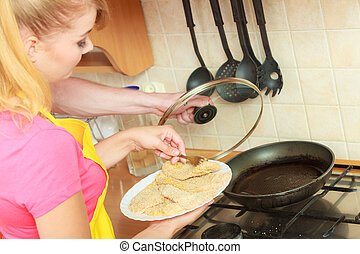 Couple woman and man frying breaded chicken cutlet - Couple...