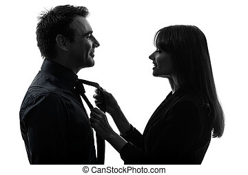 couple woman helping man tying silhouette
