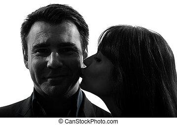 couple woman kissing man silhouette