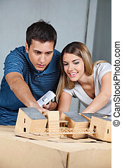 Couple Working On Model House