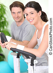 Couple working out together at the gym