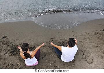 couple yoga beach