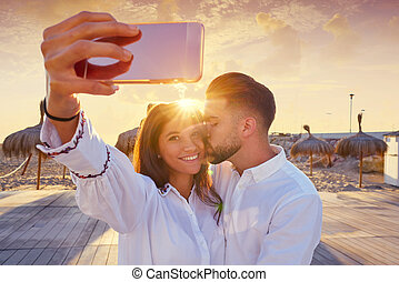 Couple young selfie photo in beach vacation