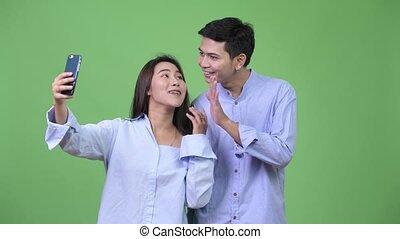 couples affaires, jeune, ensemble, appeler, vidéo, asiatique