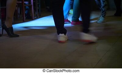 Couples dancing kizomba in the club.
