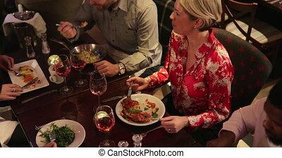 Couples Enjoying Food Together - High angle view of three...