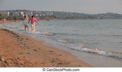 Couples Having Fun At The Beach