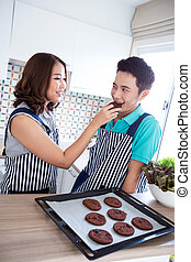 Couples in domestic kitchen with breakfast