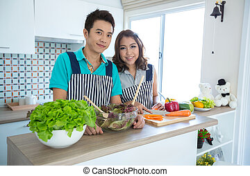 Couples in kitchen - Young happy couples in domestic kitchen