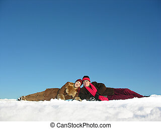 couples lies on snow
