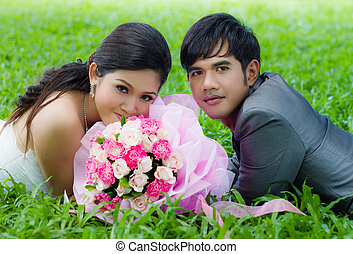 Couples of groom and bride with bouquet flowers