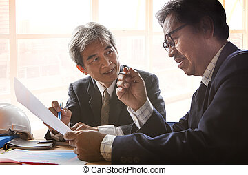 couples of senior partner business man meeting with serious...