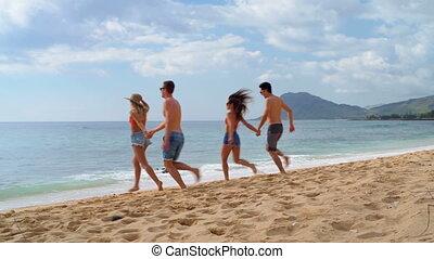 Couples running on the beach 4k