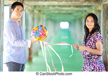 couples with beautiful bouquet
